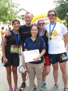 Friends runners (from left) Kanchan, Steinunn and Allan with Laos Country Program Director Ket and event organizer Michael.
